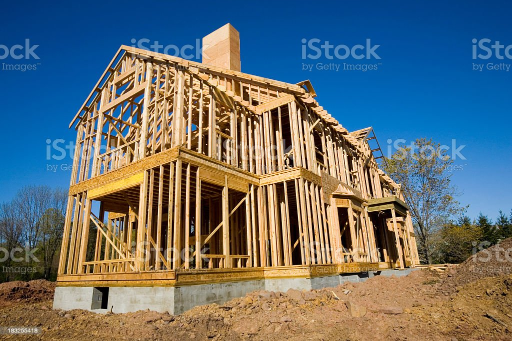 Wooden frame to a large residential home royalty-free stock photo