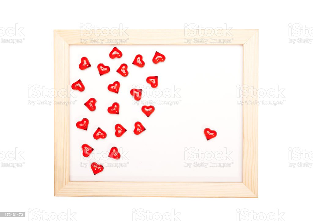 Wooden frame with hearts royalty-free stock photo