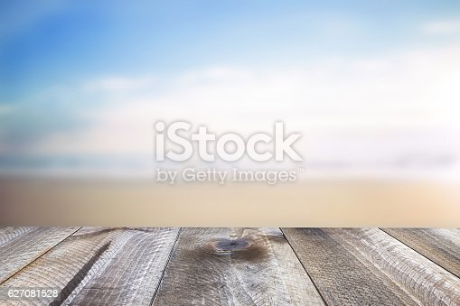 istock Wooden free space on table and summer sea landscape 627081528