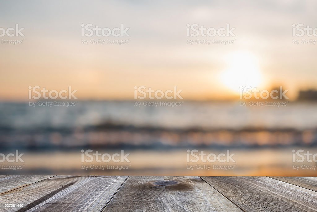 Wooden free space on table and sunset over the sea stock photo