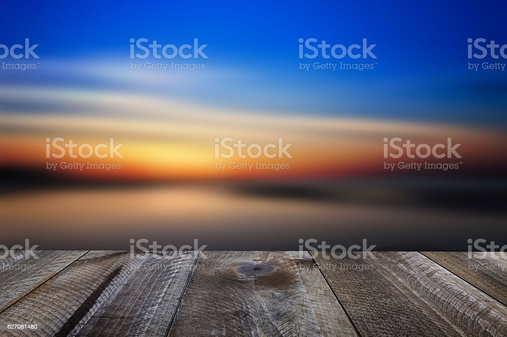 Wooden free space on table and sunset over the sea - foto de acervo