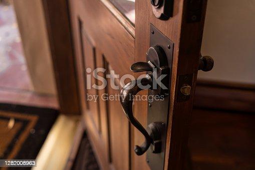 istock Wooden Front Door Left Open 1282008963