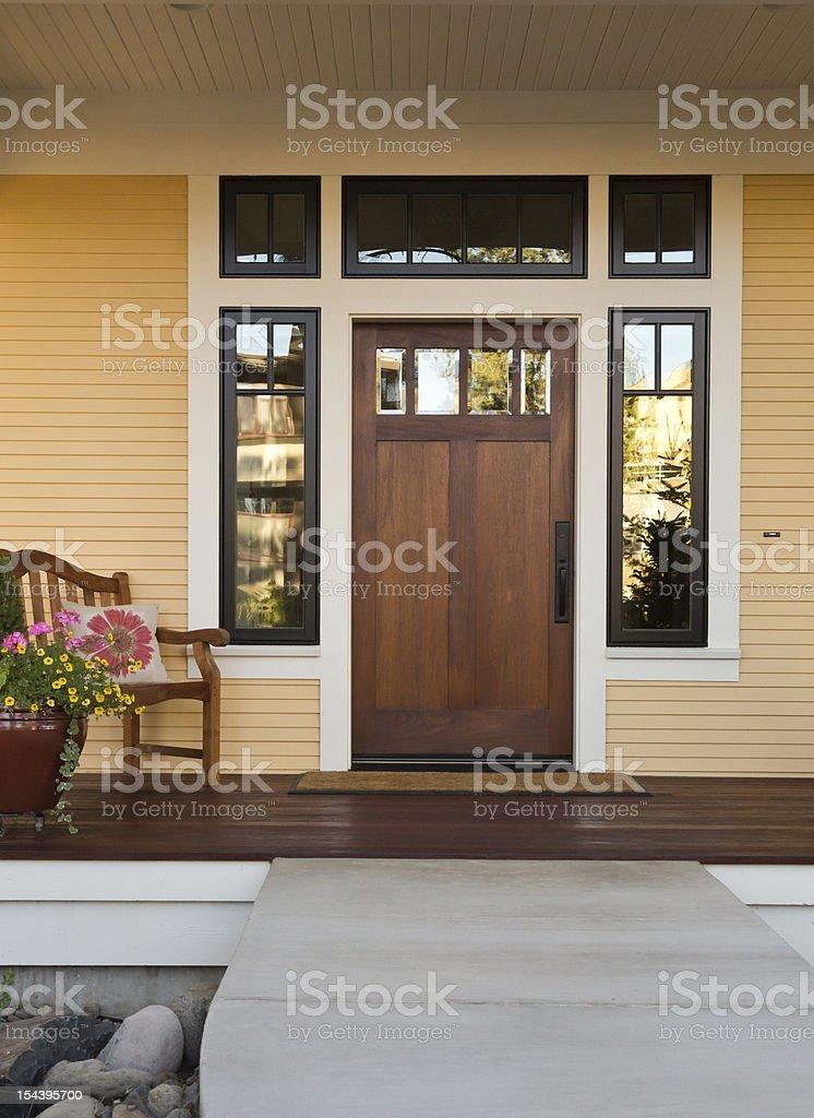 Wooden Front Door of a Home stock photo