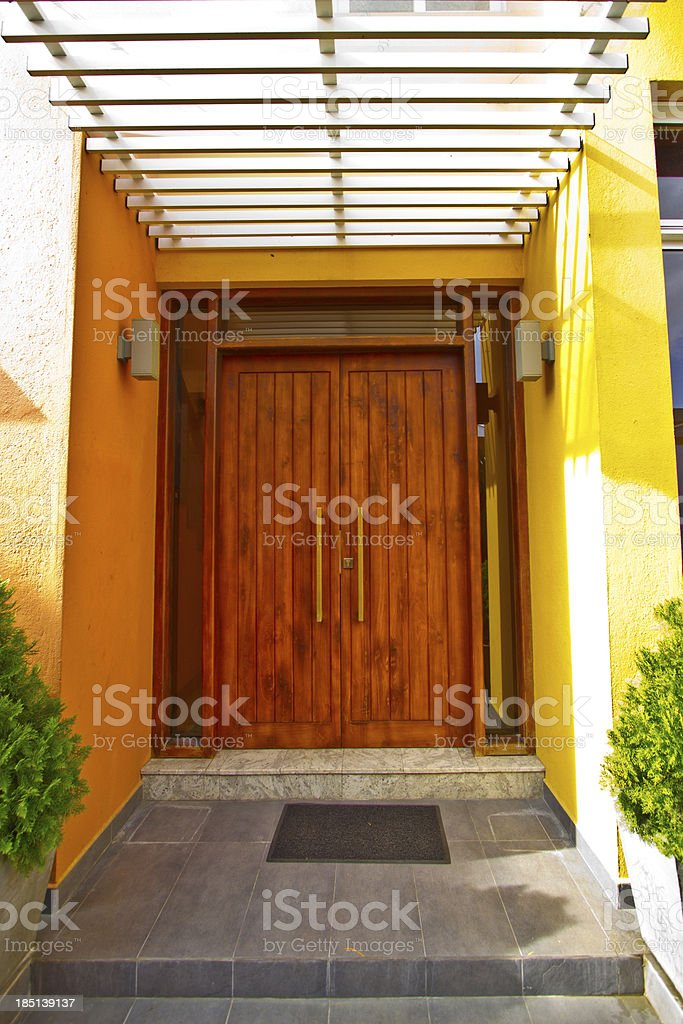 Wooden Front Door of a Modern House royalty-free stock photo