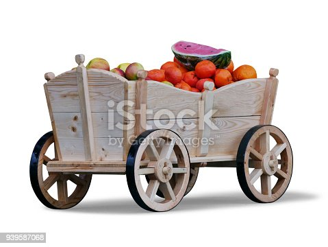 Retro style wooden fruit cart full with fruits,isolated on white background with a drop shadow.
