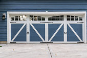 American wooden garage with driveway