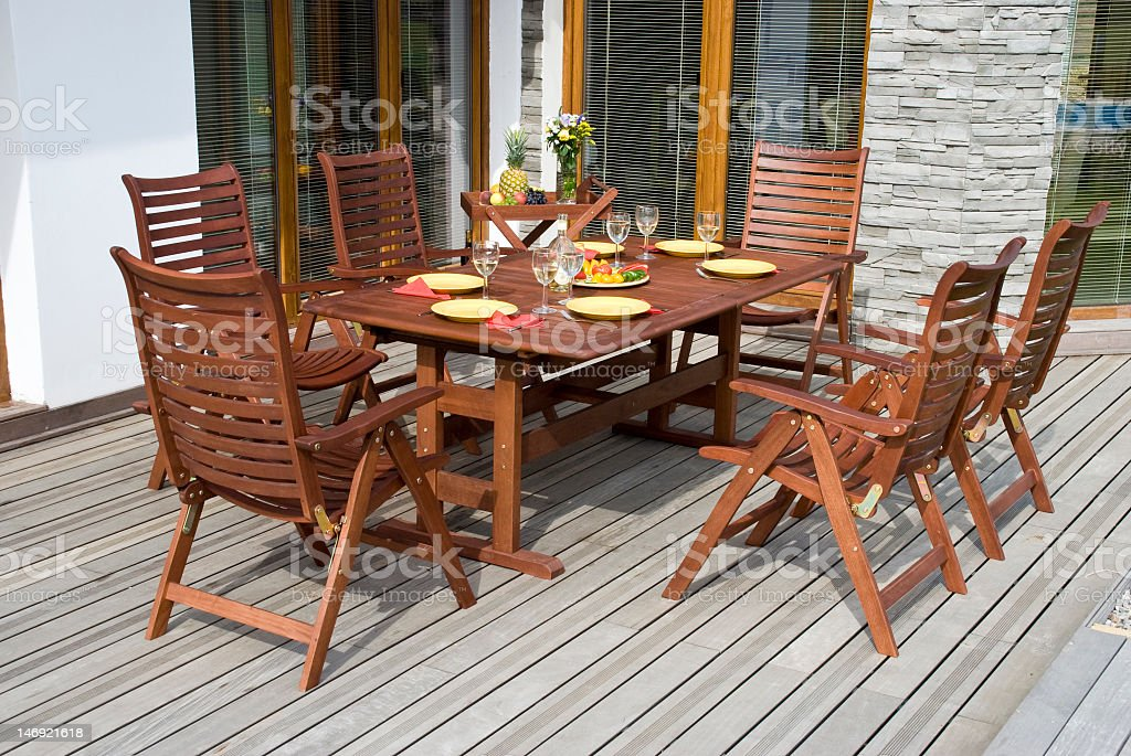 Wooden garden furniture on a sun deck stock photo