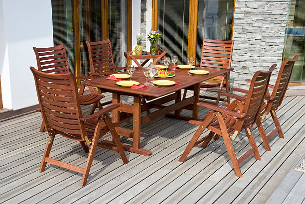 Wooden garden furniture on a sun deck stock photo