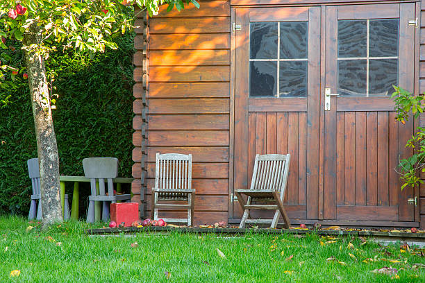 Wooden garden tool shed in a beautiful park stock photo