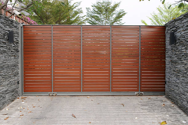 Wooden Gate of a Luxury Suburban House stock photo