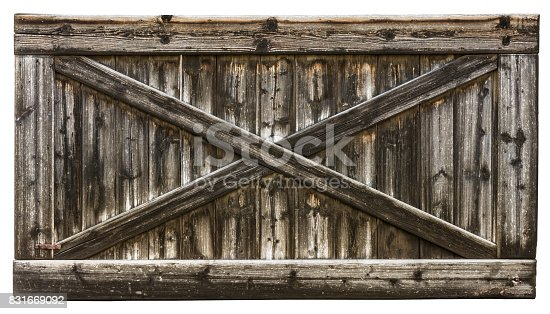 istock Wooden gate with cross from laths 831669092