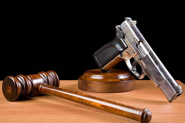 Wooden Gavel And Handgun On Table For Crime Punishment Concept stock photo