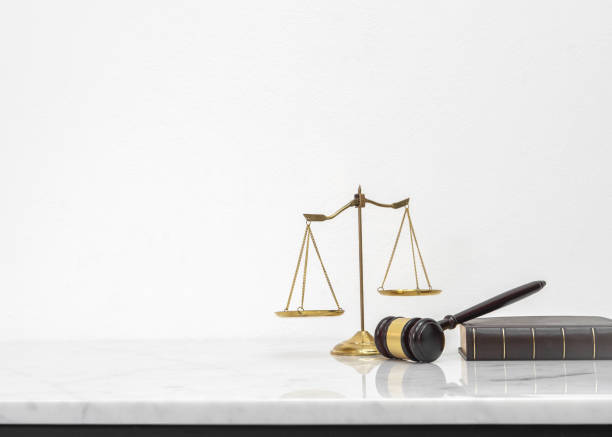 Wooden gavel and law book put on white marble table top counter with copy space. stock photo