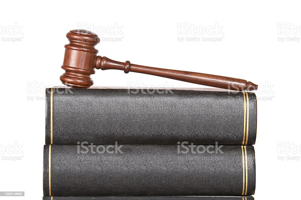 Wooden gavel and law books royalty-free stock photo