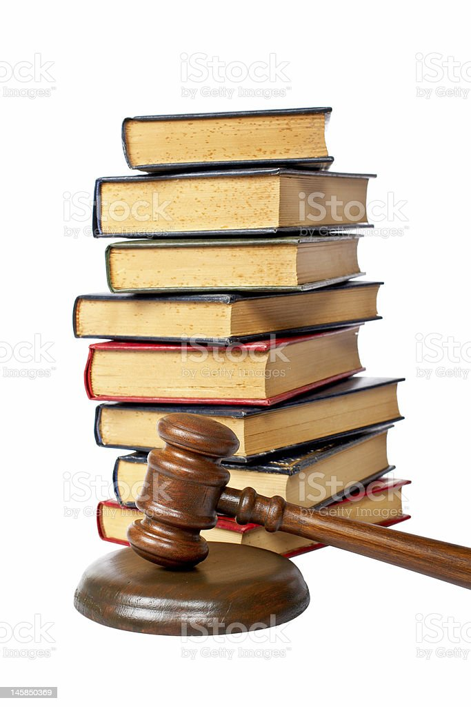 Wooden gavel and old law books stock photo
