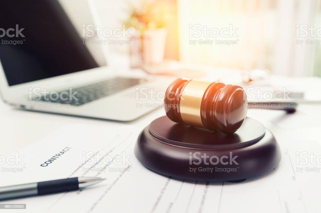 Wooden gavel at lawyer or attorney office. zbiór zdjęć royalty-free