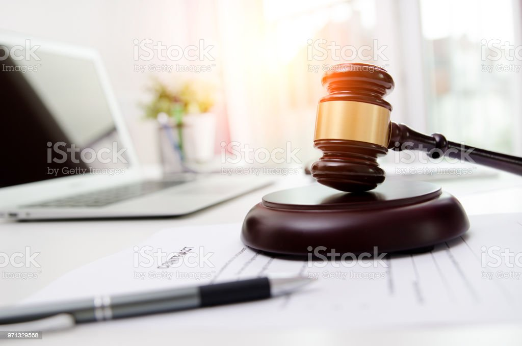 Wooden gavel at lawyer or attorney office stock photo