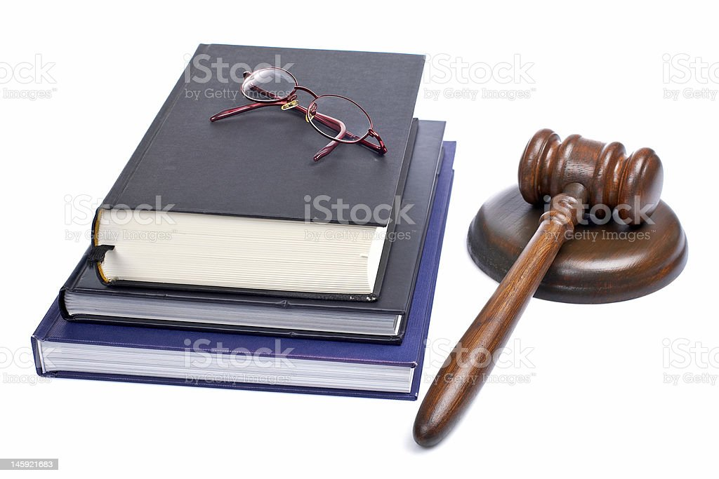 Wooden gavel, glasses and law books royalty-free stock photo