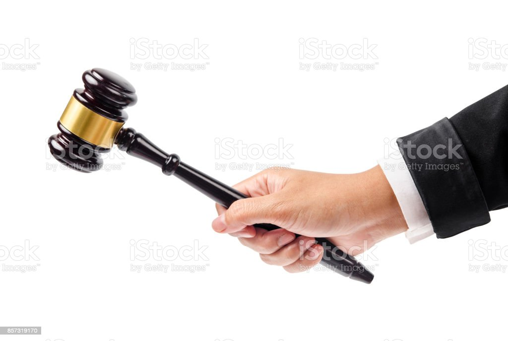 wooden gavel in hand isolated on white stock photo