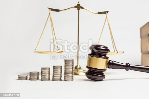 istock Wooden gavel of lawyer justice with coin currency. 849951778