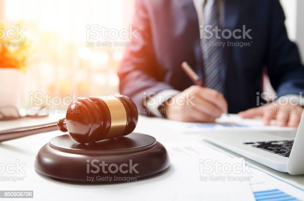 Wooden Gavel On Table Attorney Working In Courtroom Stock Photo - Download Image Now