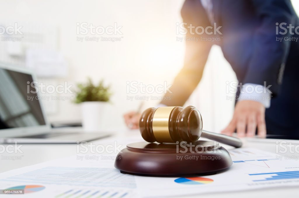 Wooden gavel on table. Attorney working in office zbiór zdjęć royalty-free