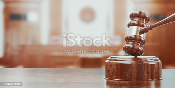 istock Wooden gavel on table close up. 3d rendering 1200335632