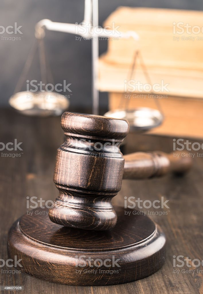 Wooden gavel on table stock photo