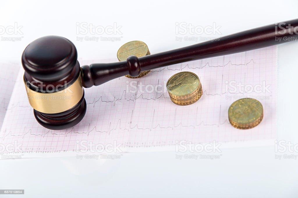 Wooden gavel on white background isolated with EKG, ECG stock photo