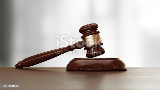 Wooden gavel over defocused background. Front view with selective focus. Great use for law, justice and auction related concepts.