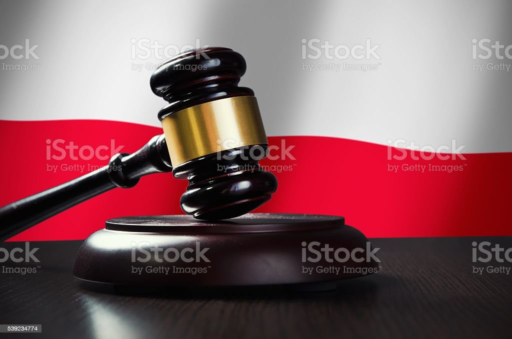 Wooden gavel with Polish flag in background royalty-free stock photo