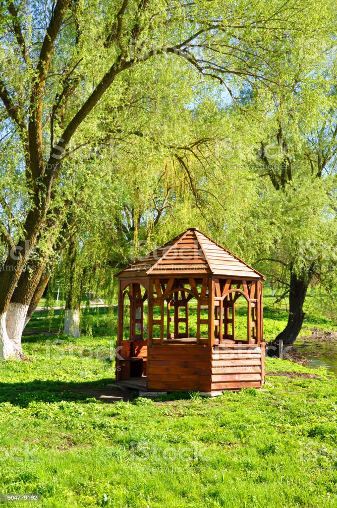 wooden gazebo on the river bank royalty-free stock photo