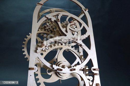 wooden gear mechanism. Designer item for decoration.