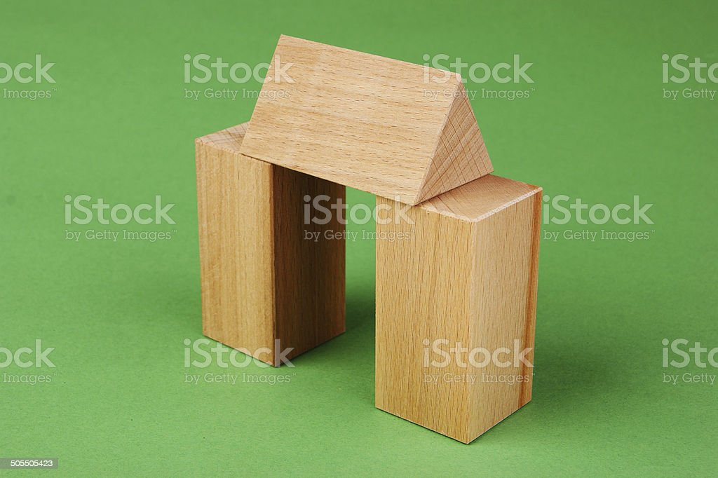 wooden geometric shapes on a green background royalty-free stock photo