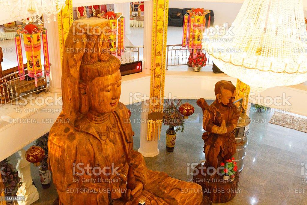 wooden goddess of mercy (Guan Yin) statue royalty-free stock photo