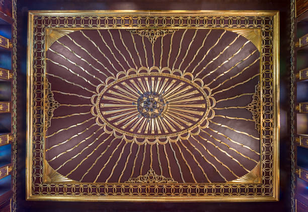 Wooden golden ornate ceiling with design based on sun rays inspired by the old flag of the ottoman empire, Cairo, Egypt stock photo