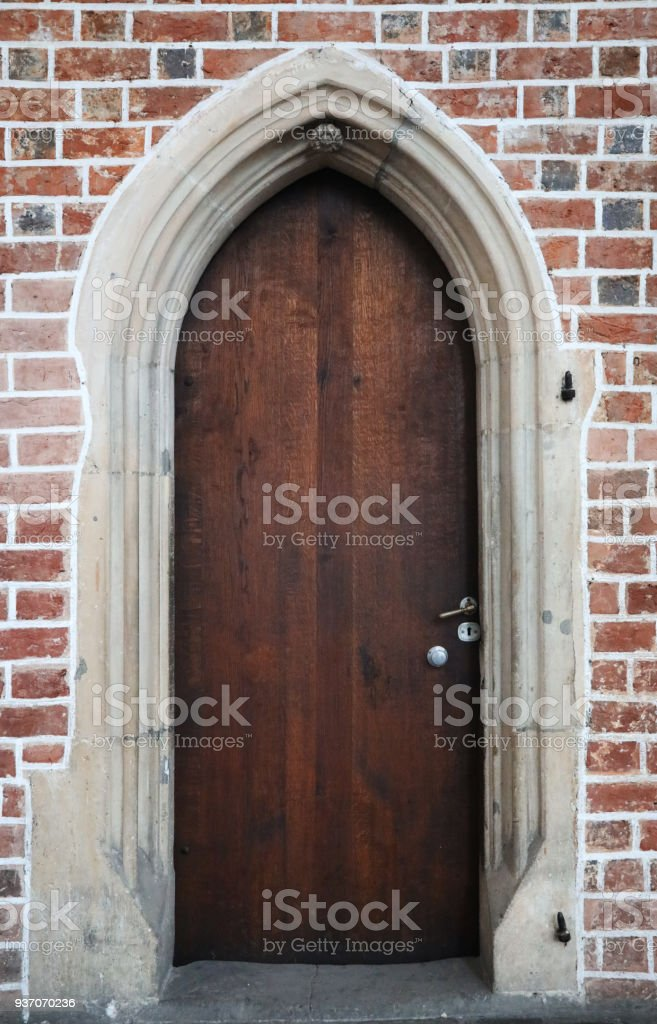 wooden gothic doors in a brick wall royalty-free stock photo & Wooden Gothic Doors In A Brick Wall Stock Photo u0026 More Pictures of ...