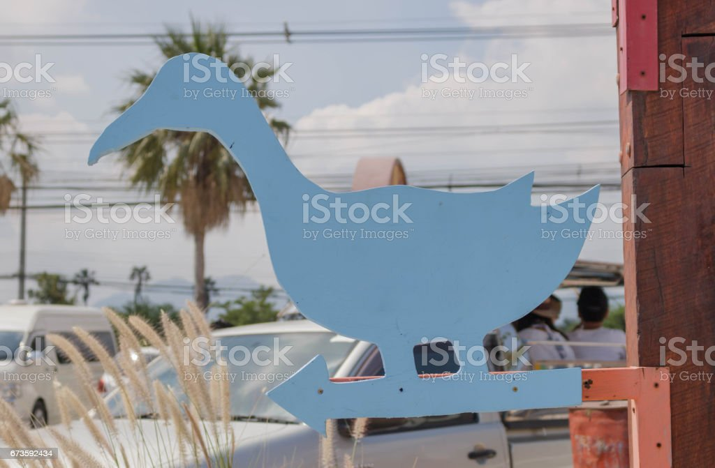 Wooden guidepost sign duck stock photo