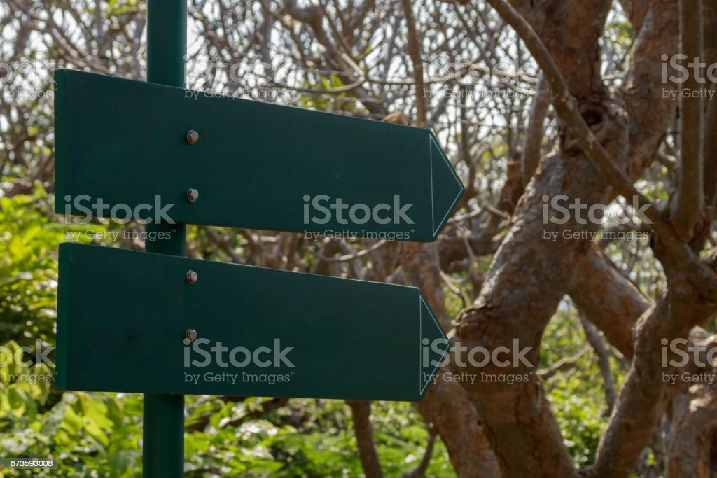 Wooden guidepost sign stock photo