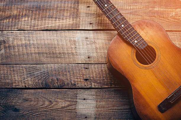 Wooden guitar. Close-up of guitar lying on vintage wood background folk music stock pictures, royalty-free photos & images