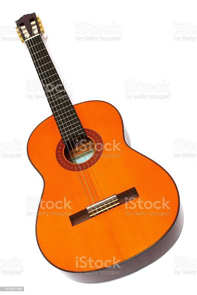 A wooden guitar with nylon strings on a white background royalty-free stock photo