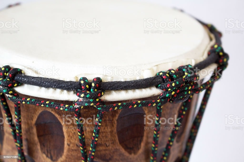 Wooden hand drum on a monophonic, white background.  Close-up. stock photo