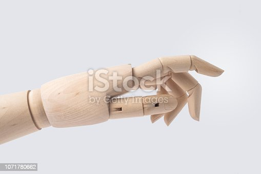 istock wooden hand with start posture isolated on white 1071780662