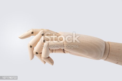 istock wooden hand with start posture isolated on white 1071780722