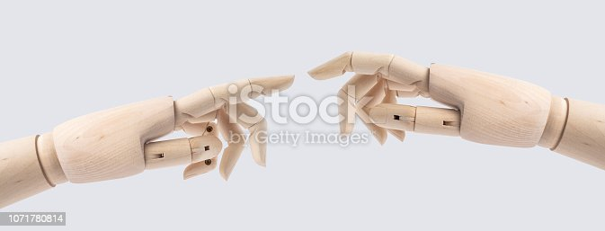 istock wooden hand with start posture isolated on white 1071780814