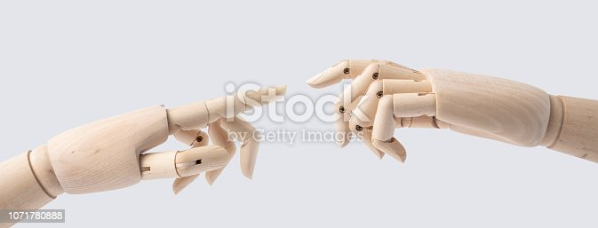 istock wooden hand with start posture isolated on white 1071780888