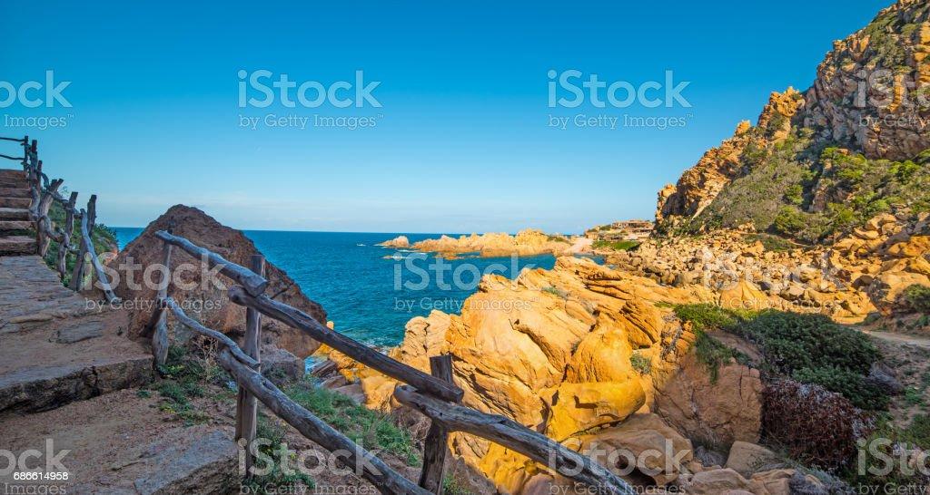 Wooden handrail in Sardinia royalty-free stock photo