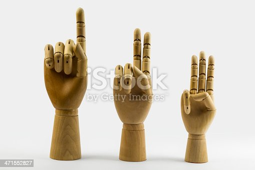 istock Wooden hands show one, two, three fingers 471552827