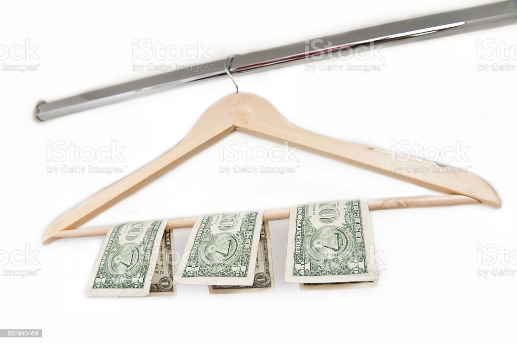 Wooden hanger with american paper money (Click for more) stock photo