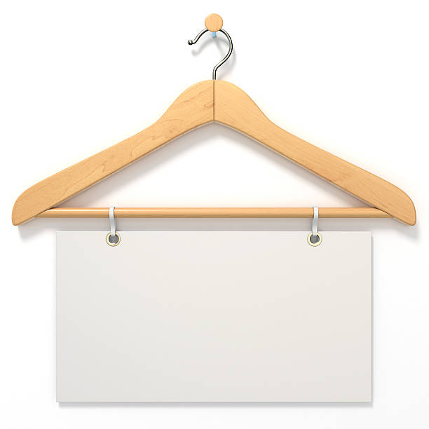 Wooden hanger with blank tag. 3D Wooden hanger with blank tag. 3D render illustration isolated on white background coathanger stock pictures, royalty-free photos & images